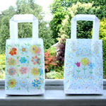 'tapestry' and 'flower trio' gem gift bags for flower city tissue